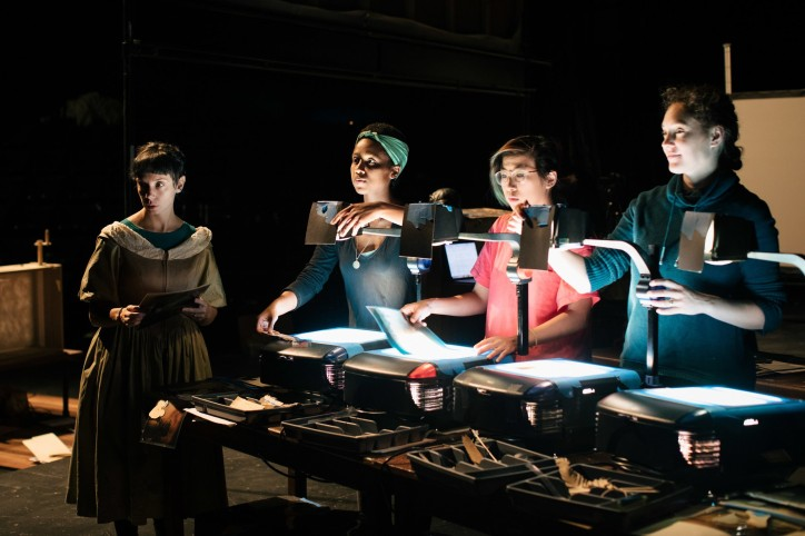 From left, the puppeteers Sarah Fornace, Leah Casey, Myra Su and Sara Sawicki, adjusting puppets on the projectors.